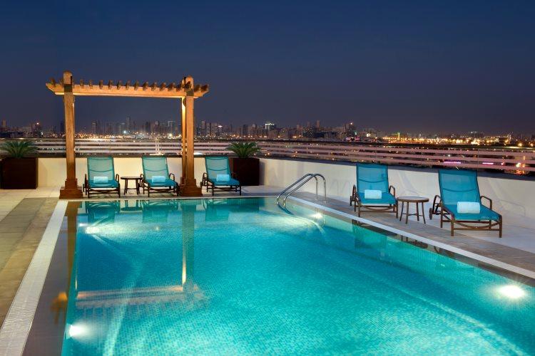 Hilton Garden Inn Al Muraqabat - Piscine
