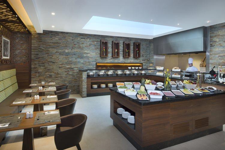 Hilton Garden Inn Al Muraqabat - The Garden Grille Restaurant