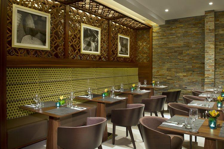 Hilton Garden Inn Al Muraqabat - The Garden Grille